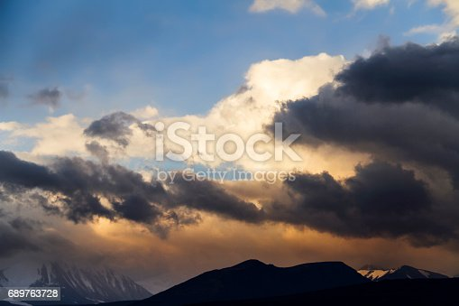 istock Altai Ukok the sunset over the mountains in cloudy cold weather. Wild remote places, no one around. Rain clouds over the mountains 689763728