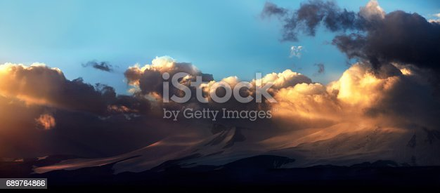 istock Altai Ukok the sunset over the mountains in cloudy cold weather. Wild remote places, no one around. Rain clouds over the mountains 689764866