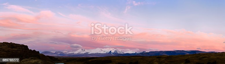 istock Altai Ukok the sunset over the mountains in cloudy cold weather. Wild remote places, no one around. Rain clouds over the mountains 689765272