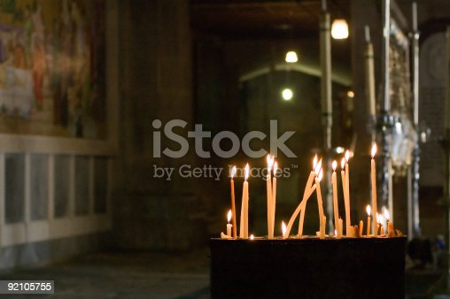 Altar and candle. Church of the Holy Sepulcher.