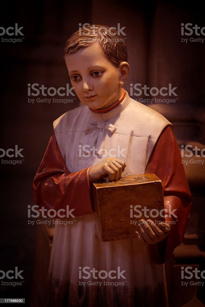 altar boy statue stock photo