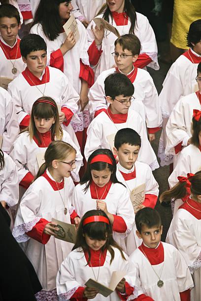 altar boys during the celebration of holy week - easter procession spain bildbanksfoton och bilder