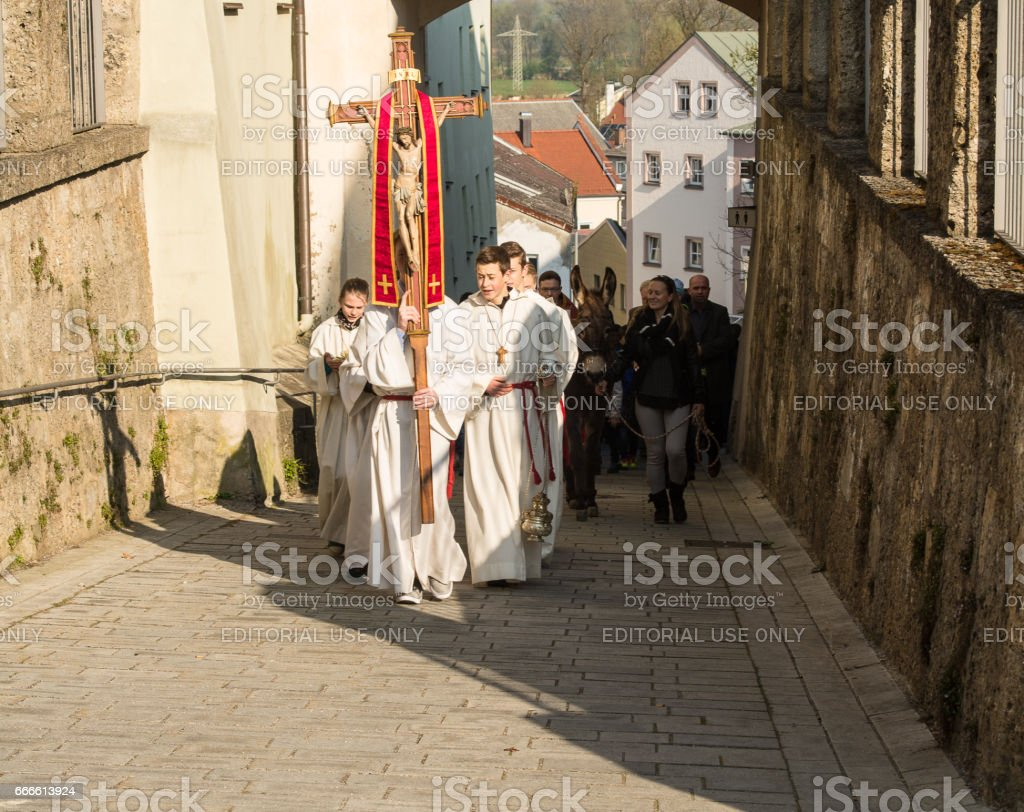 Altar boys walk at the head of the Palm Sunday procession stock photo