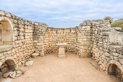 istock Altar in the ruins of ancient Greek city of Chersonesus Taurica in the Crimea peninsula under the cloudy sky, Sevastopol, Autumn 868702962