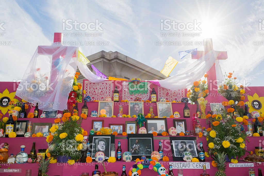 Altar with portraits flowers and drink on display stock photo