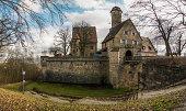 Bamberg, Germany - February 22, 2014: Bridge and fortification wall of the Altenburg near Bamberg, Bavaria.