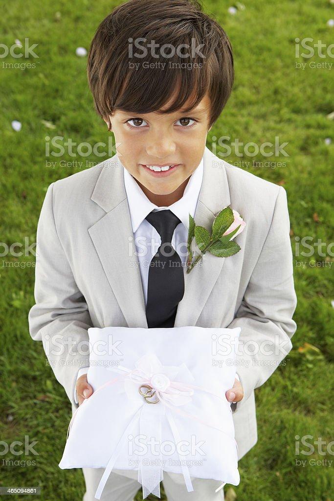 Alter boy posing with wedding ring on cushion stock photo