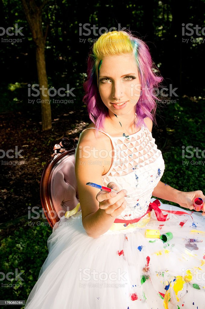 Alternative Bride Painting her Wedding Dress royalty-free stock photo
