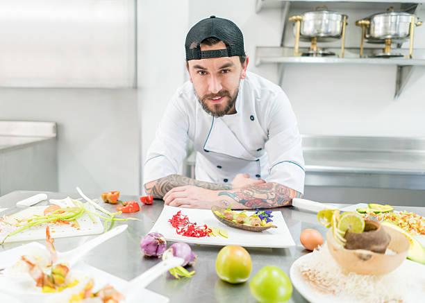 alternative chef presenting appetizers - essen tattoos stock-fotos und bilder