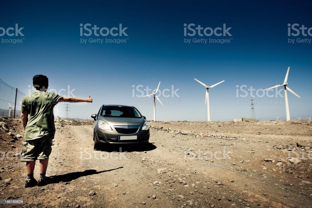 Alternative Energy Boy Hitchhiker Gran Canaria, Child Hitchhiking Series royalty-free stock photo