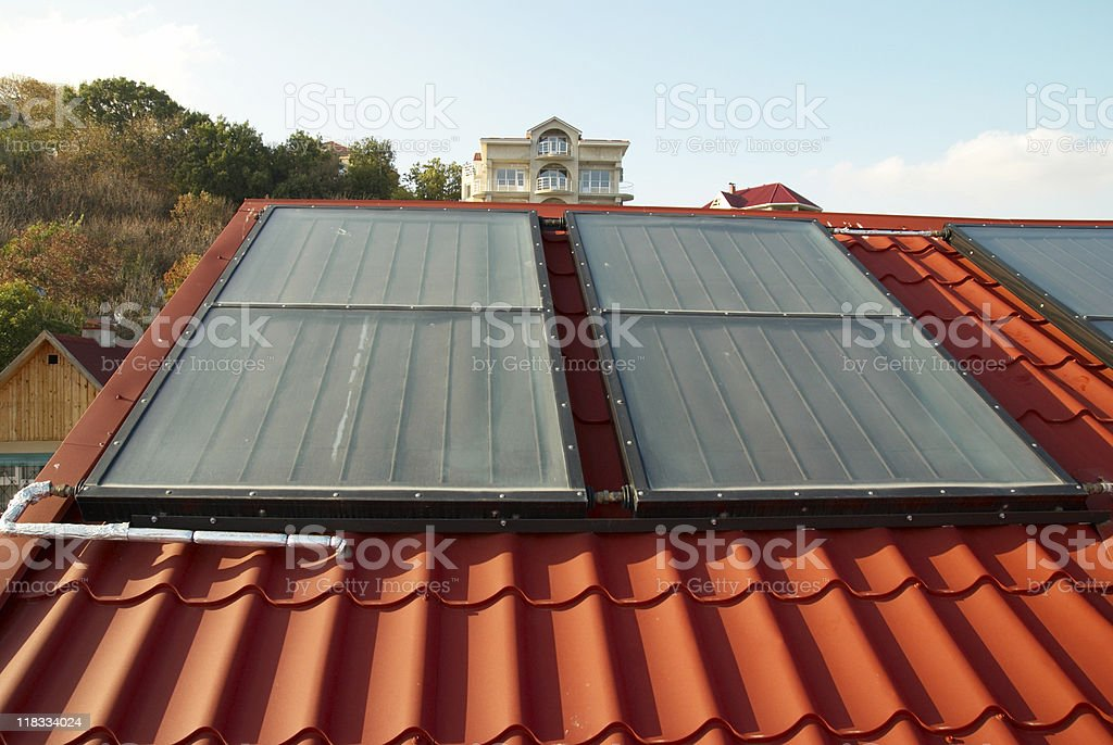 Alternative energy- solar system on the house roof. royalty-free stock photo