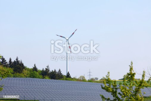480763537 istock photo alternative energy source wind generator and solar field 183868802