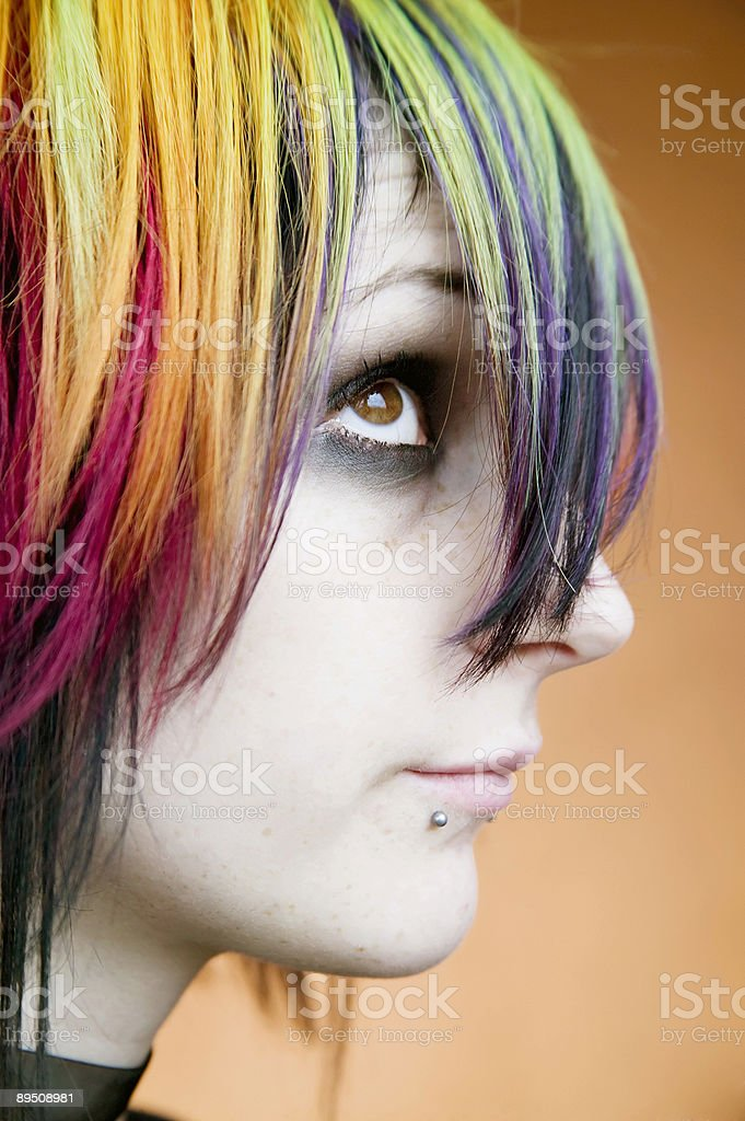 Alternative girl with multi-colred hair looks up royalty-free stock photo