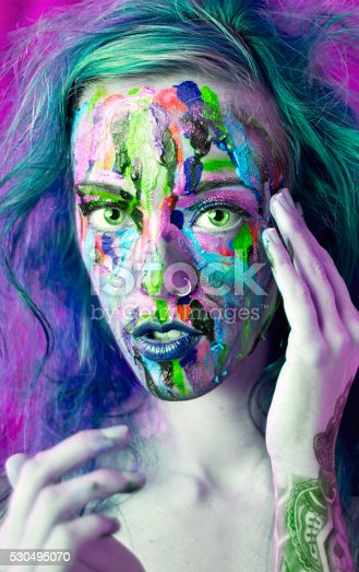 181894581 istock photo Alternative Girl With Paint on Her face making eye contact 530495070