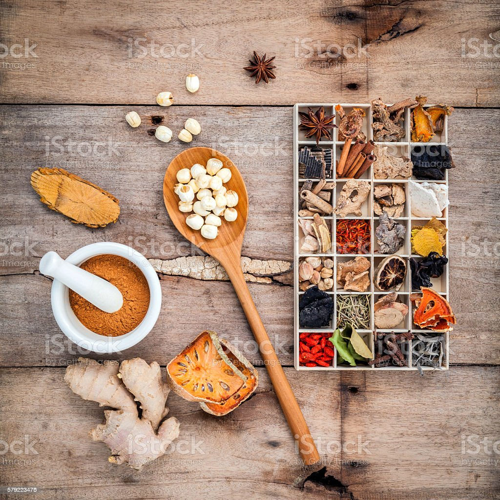 Alternative health care dried various Chinese herbs in wooden bo stock photo