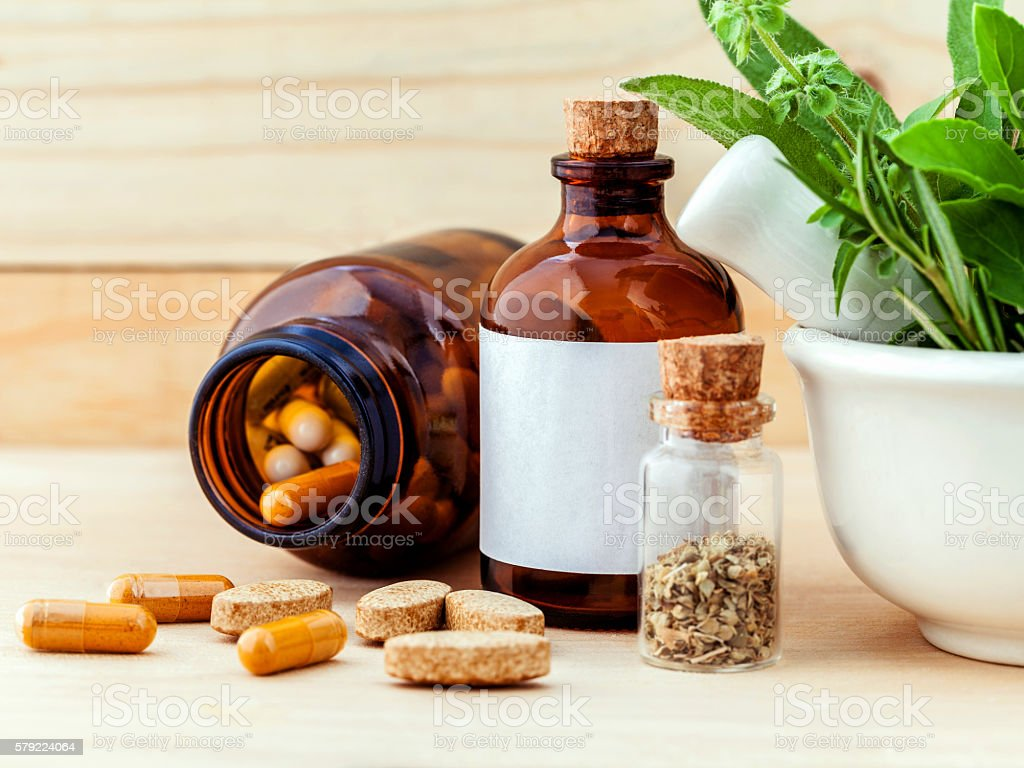 Alternative health care fresh herbal  ,dry and herbal capsule wi stock photo