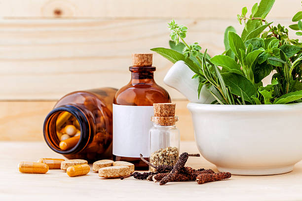 alternative health care fresh herbal  ,dry and herbal capsule wi - naturopathy stock photos and pictures