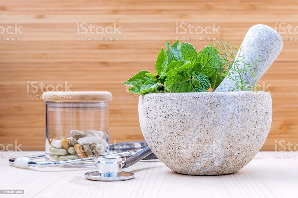 Alternative health care fresh herbs . stock photo