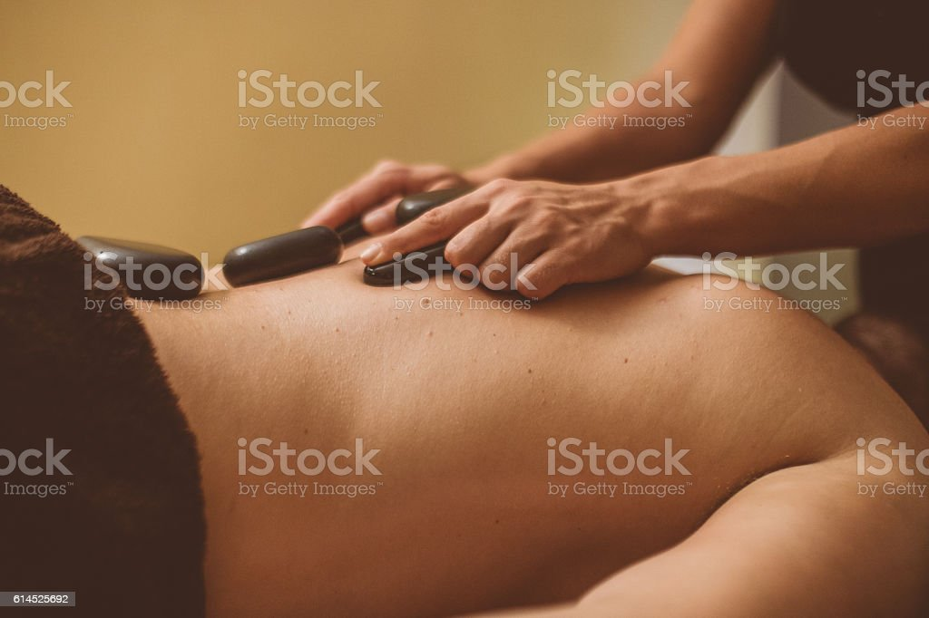 Alternative Laston Healing Massage stock photo