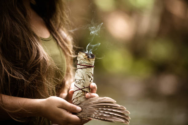Alternative Medecine, Young Woman Performing A Purification Ritual With Sage stock photo