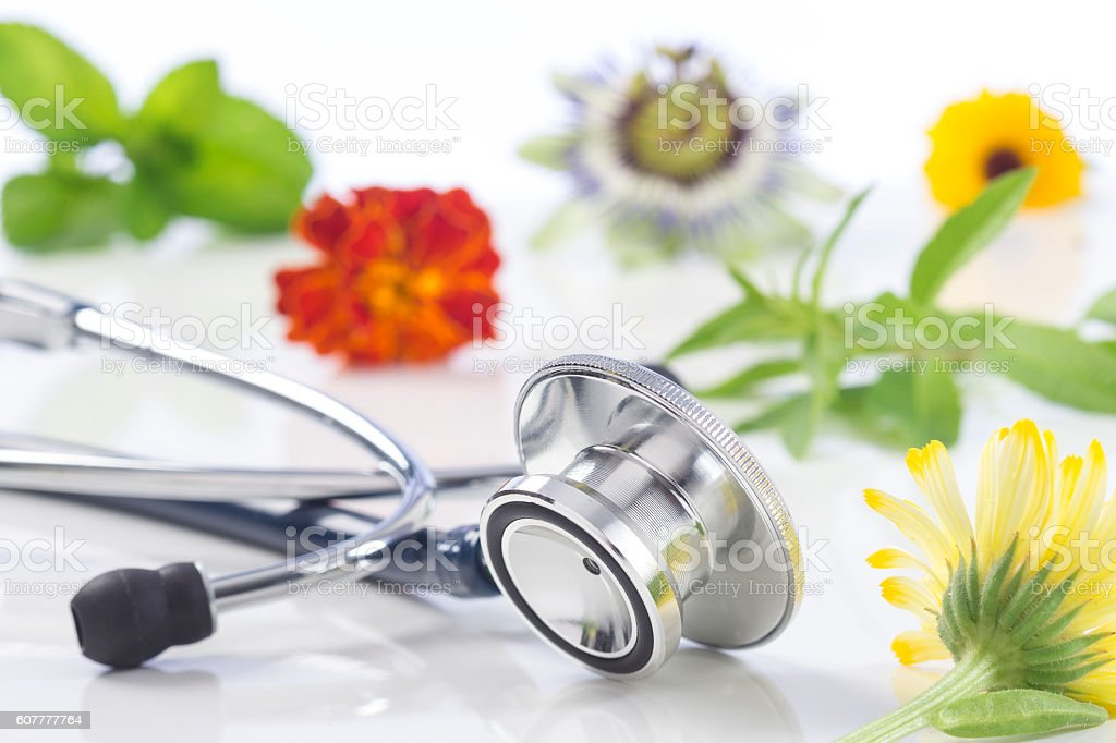 Alternative medicine herbs and stethoscope stock photo
