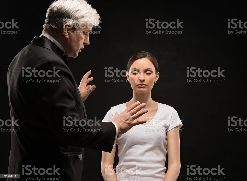 Alternative medicine therapist using hypnosis to heal the patien stock photo