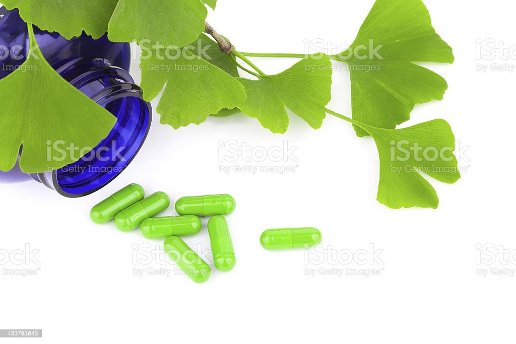 Alternative medicine:ginkgo leaf and pill isolated on white royalty-free stock photo