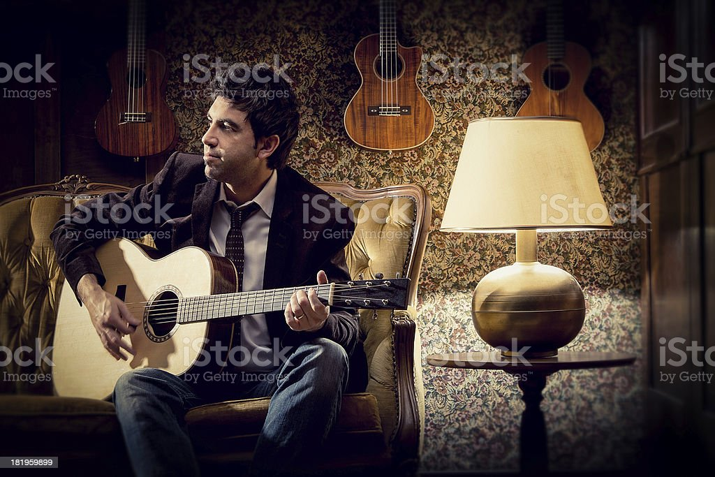 alternative singer plays guitar royalty-free stock photo