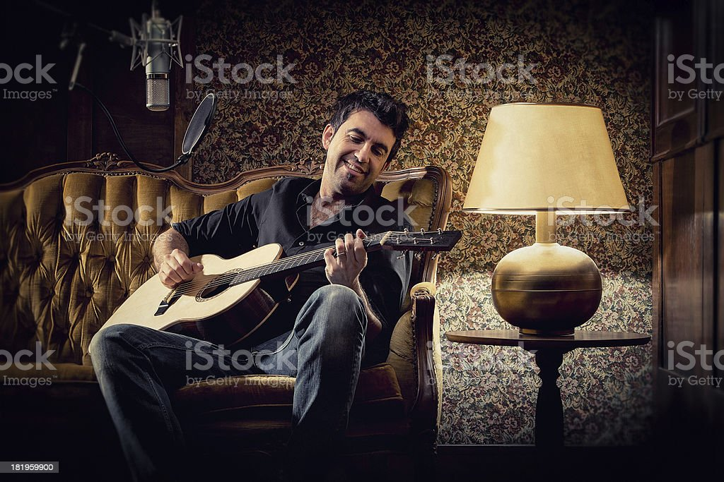 alternative singer plays guitar royalty-free stock photo