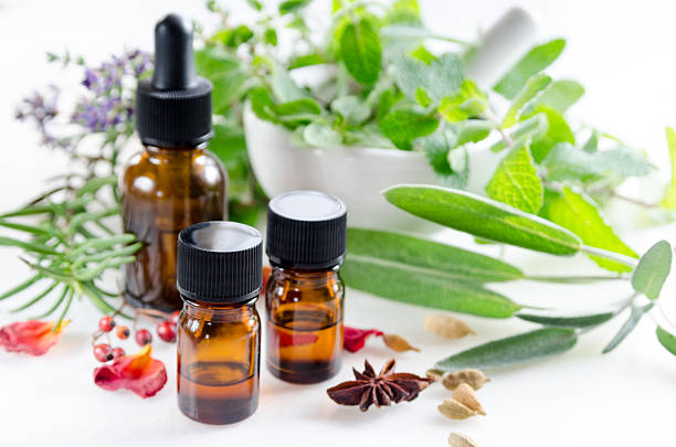 alternative therapy with herbs and essential oils - holistic medicine stock photos and pictures