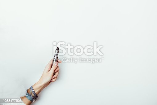 istock Alternative way of smoking with vaping device 1033177506