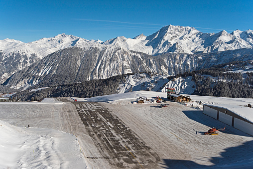 Altiport airport in a snow covered alpine mountain range