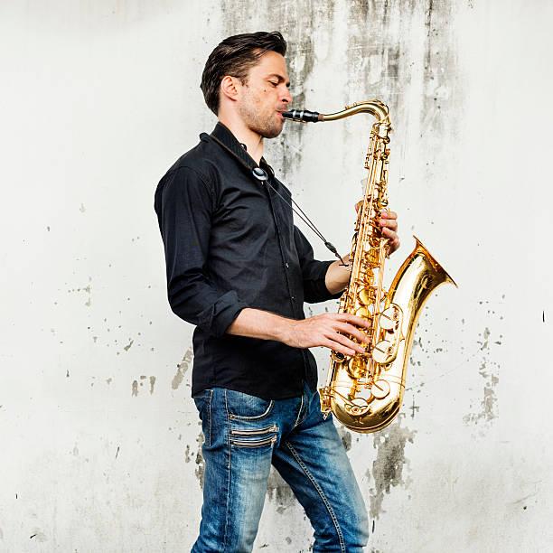 alto saxophone artist classical jazz musician sax concept - altsaxophon stock-fotos und bilder