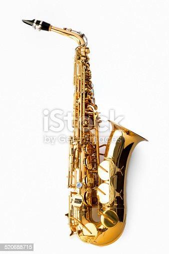 Jazz shot of a tenor saxophone, warmly lit, studio shot on white