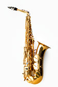Jazz shot of a tenor saxophone, warmly lit, studio shot on white