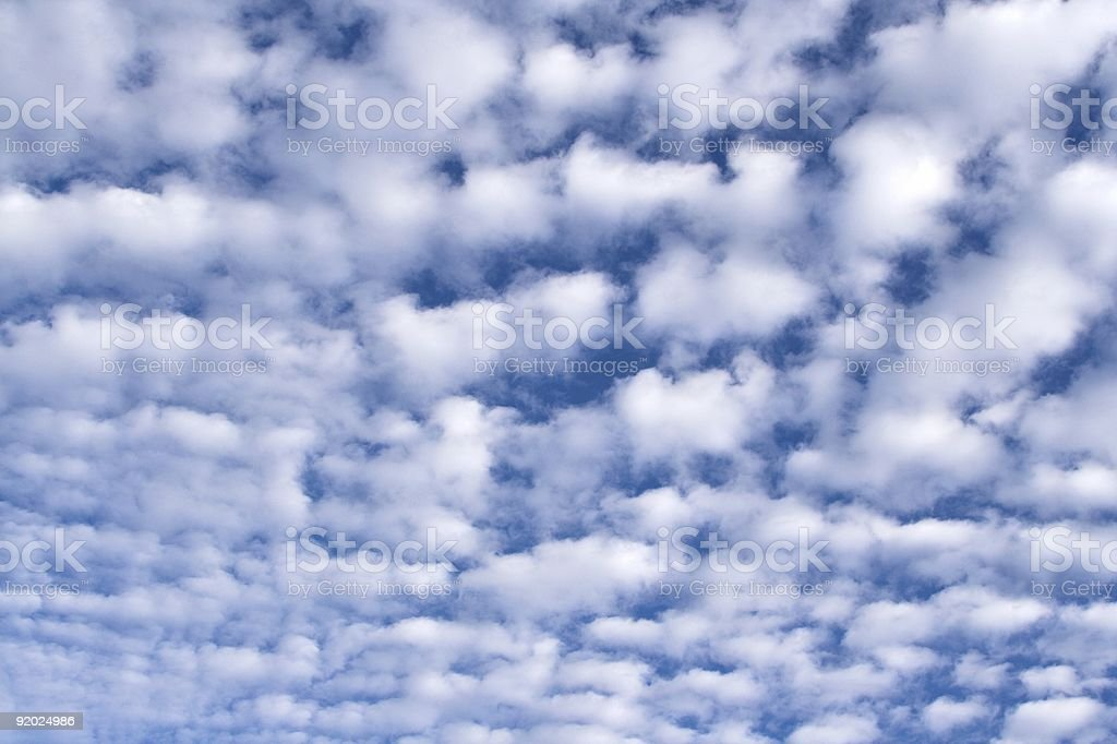 Altocumulus Clouds Against A Deep Blue Sky royalty-free stock photo
