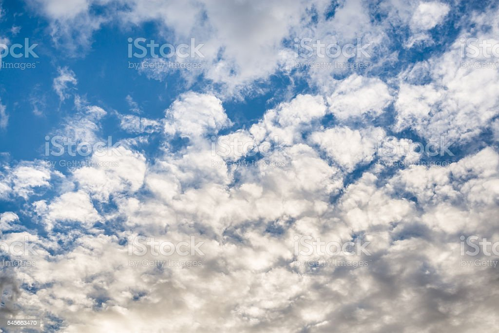 altocumulus clouds and blue sky stock photo