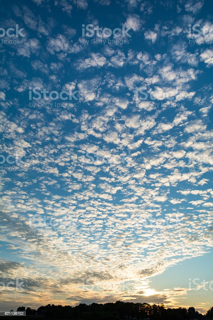 Altocumulus clouds at sunset stock photo