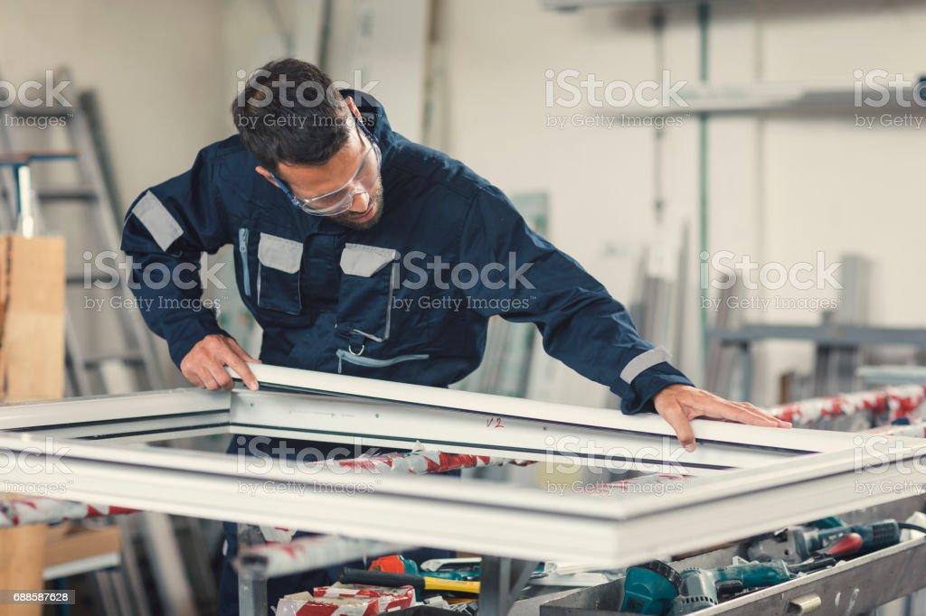 Aluminium and PVC industry worker stock photo