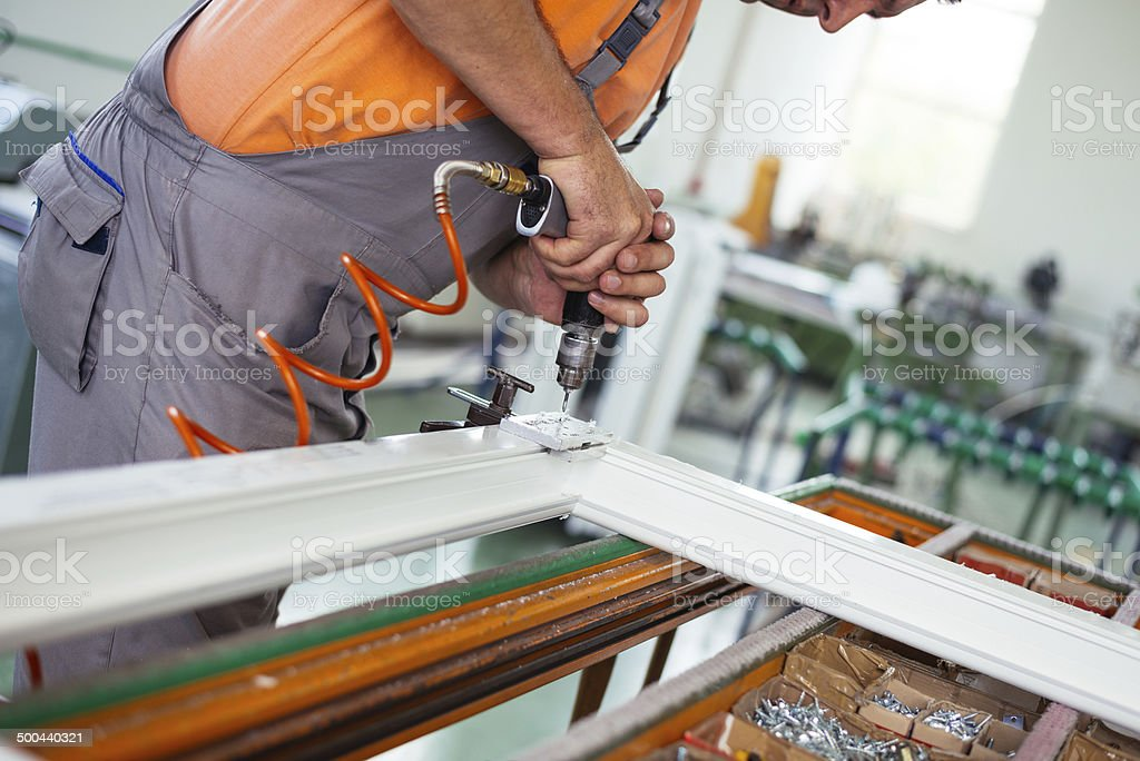 Aluminium and PVC windows industry worker stock photo