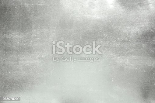 istock aluminium background or texture and gradients shadow.  silver background. 973075292