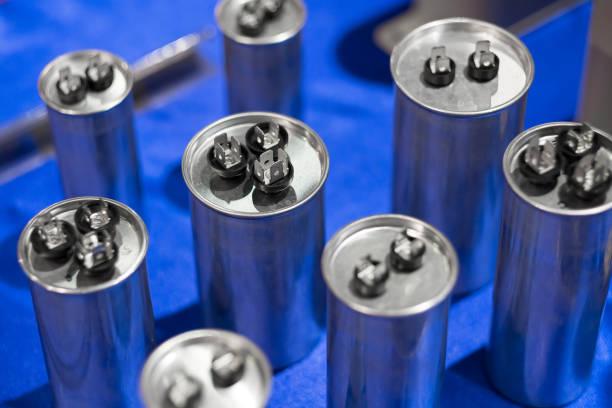 aluminium can type film capacitors - capacitor stock photos and pictures
