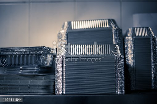 Aluminium foil plates, tray or tiffin container box staged on the rack at the restaurant