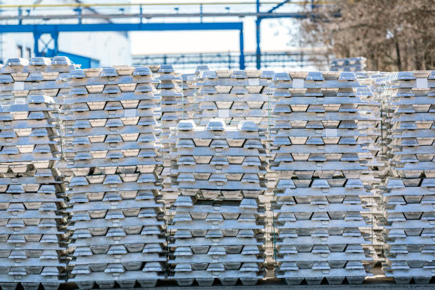Aluminium ingots in outside field of factory. The Hall