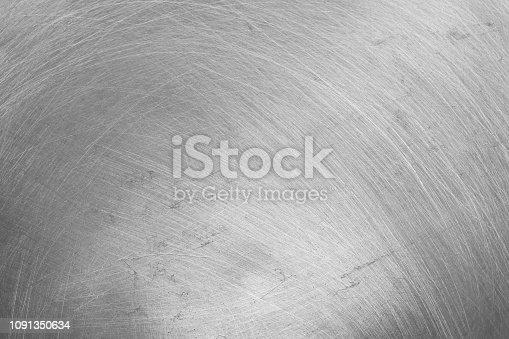 istock aluminium texture background, scratches on stainless steel. 1091350634