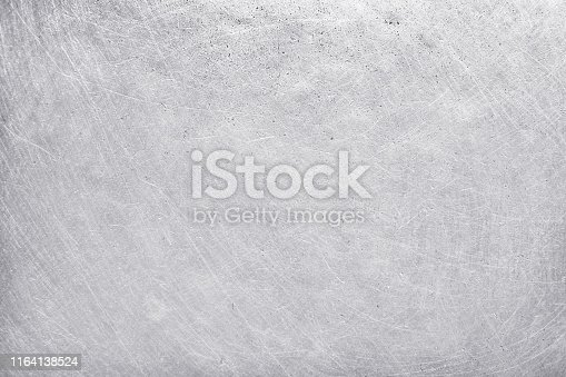 istock aluminium texture background, scratches on stainless steel. 1164138524