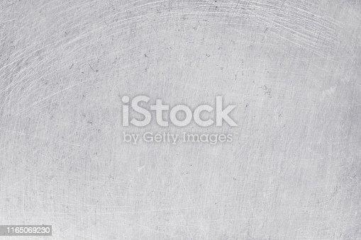 istock aluminium texture background, scratches on stainless steel. 1165069230