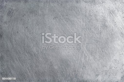 istock aluminium texture background, scratches on stainless steel. 934499118