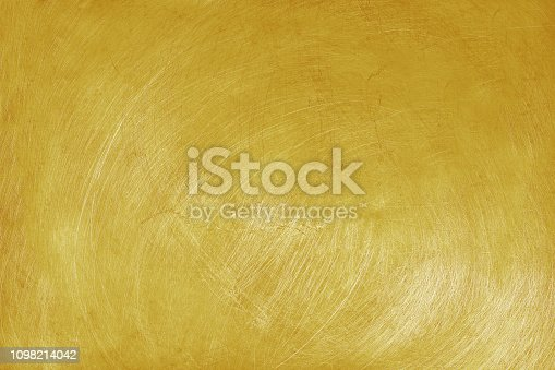 istock aluminium texture background with golden color, pattern of scratches on stainless steel. 1098214042