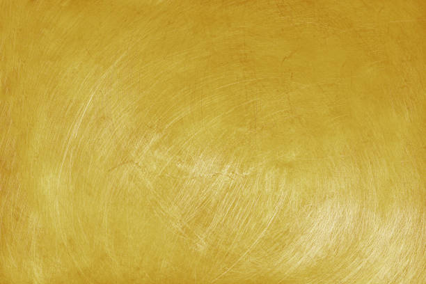 aluminium texture background with golden color, pattern of scratches on stainless steel. stock photo